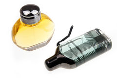 Two perfumes. Man's perfume and women perfume are on the white background Royalty Free Stock Photos