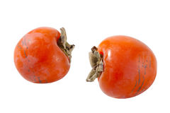 Two persimmon fruit Stock Photos
