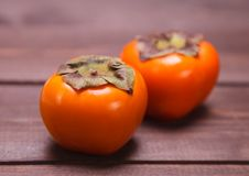 Two persimmons Stock Image
