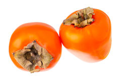 Two persimmons. Two persimmons closeup isolated on white background Royalty Free Stock Image