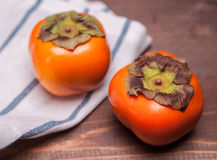 Two persimmons Stock Images