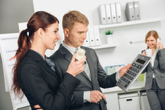 Two person calculating heating costs. In office Stock Images