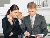 Two person calculating heating costs Royalty Free Stock Photography