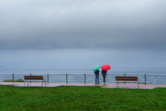 Two person with colorful umbrellas. On rainy day Royalty Free Stock Photography