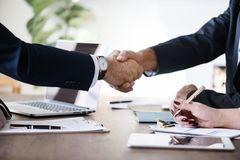 Two Person in Formal Attire Doing Shakehands Stock Image