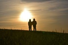 Two person in front of the sunset royalty free stock photo