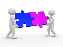 Two person matching puzzle pieces Royalty Free Stock Photo