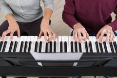 Two person playing keyboards. Two person playing the keyboards Stock Photography