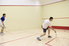 Two person playing squash Stock Photos