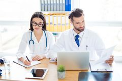 Two person: professional doctor and his assistant in glasses coo stock images