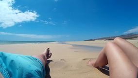 Two person relax on a beach on Fuerteventura - Spain - Canary Islands. Two person relax on a beach on Fuerteventura - Spain stock footage