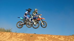 Two Person Riding Motocross Dirt Bikes Stock Image