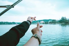 Two Person's Left Hand Making Finger Heart Sign Near Body of Water Stock Images