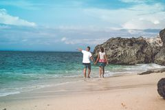 Two Person Walking on Sea Shore Royalty Free Stock Photos