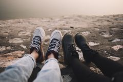 Two Person Wearing Pants and Shoes Sits on Ground at Daytime Royalty Free Stock Photos