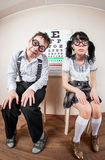 Two person wearing spectacles in an office at the doctor Stock Image