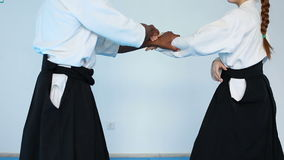 Two persons in black hakama practice Aikido on martial arts training. Two persons in black hakama practice the Aikido on martial arts training stock footage