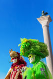 Two persons with carnivals masks in Venice. Picture of two persons with carnivals masks in Venice, Italy stock photo