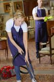 Two persons cleaning house. Two persons cleaning a house Royalty Free Stock Photo