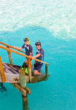 Two persons with the equipment for a snorkeling at Royalty Free Stock Image