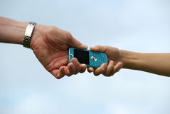 Two persons fighting over a cellphone Royalty Free Stock Photography