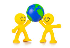 Two persons have control over globe. Stock Images