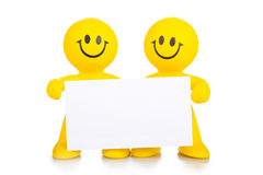 Two persons hold the pure white poster Stock Image