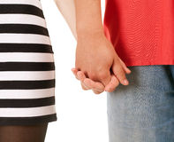 Two persons holding on hands Stock Photo