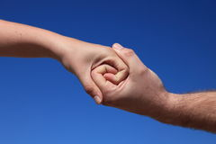Two persons holding hands Royalty Free Stock Image