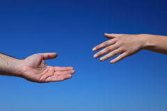 Two persons reaching hands Royalty Free Stock Images