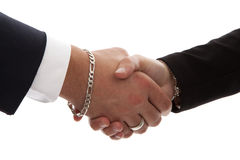 Two persons shaking hands in closeup Royalty Free Stock Image
