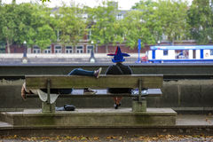 Two persons sit in  front of Thames River Stock Photography