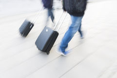 Two persons with small black suitcases Stock Photography