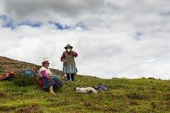 Two Peruvian women farmers near Maras, Peru. Maras, Peru - December 23, 2013: Two Peruvian women farmers having a break form their work, in the Moray Inca Stock Photo
