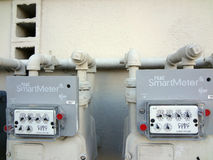Two PG&E (utility co)  electricity SmartMeters on residential bu Stock Photos