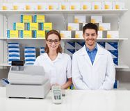 Two pharmacist in pharmacy Stock Photography