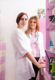 Two pharmacist woman at work place Royalty Free Stock Images