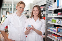 Two Pharmacists Consulting Each Other Royalty Free Stock Image