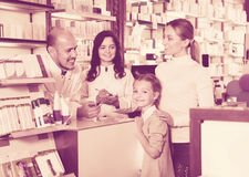 Two pharmacists helping customers Stock Photos