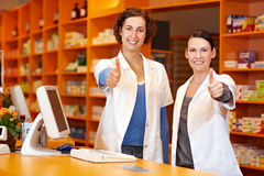 Two pharmacists holding thumbs up Royalty Free Stock Images