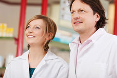 Two pharmacists looking up Royalty Free Stock Photography