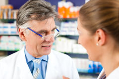 Two pharmacists in pharmacy consulting Stock Photo