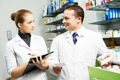 Two pharmacy chemist workers in drugstore Stock Photo