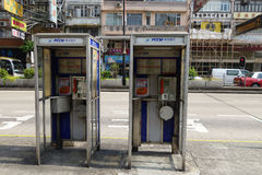 Two phone booths locate in Mong Kok in Hong Kong Royalty Free Stock Image