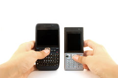 Two phones hands whote Royalty Free Stock Photography