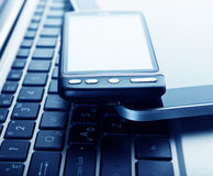 Two phones and tablet pc on laptop Royalty Free Stock Photography