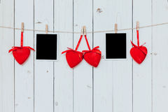 Two photo frame blank and red heart hanging on white wood backgr Stock Photography
