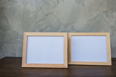 Two photo Frame on a wooden on Gray wall background . Royalty Free Stock Images