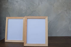 Two photo Frame on a wooden on Gray wall background . Royalty Free Stock Photography