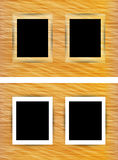 Two photo frames on abstract wooden background Royalty Free Stock Image